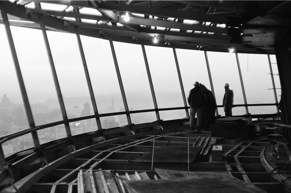 Courtesy of The Seattle Public Library, [spl_gg_76240008] Title: Workers inside Space Needle restaurant level, ca. early January 1962 Identifier: spl_gg_76240008 Subjects (LCSH)): Century 21 Exposition (1962 : Seattle, Wash.) Space Needle (Seattle, Wash.) Construction--Washington (State)--Seattle Construction workers Structural steel workers Seattle (Wash.)--Aerial views Photographer: Gulacsik, George, 1923-2010 Date: 1962-01 Decade: 1960-1969 Notes: Because no images in this collection were dated, dates provided are approximations based on the construction notebook kept by George Gulacsik (a digital version of which is available through this collection), Seattle Times articles and other resources. Collection: George Gulacsik Space Needle Photograph Collection Box: 4 Folder: 28 Film Format: black and white negative Physical Measurements: 35mm Type: image Local Type:photograph Digitization Specifications: Master image scanned with Noritsu Koki QSS-32_33 at 72 pixels per inch, 24 bit color, and saved as a JPG file. Master image file size: 1,988,701 bytes. Rights and Reproduction: For information about rights and reproduction, visit http://cdm16118.contentdm.oclc.org/cdm/rights